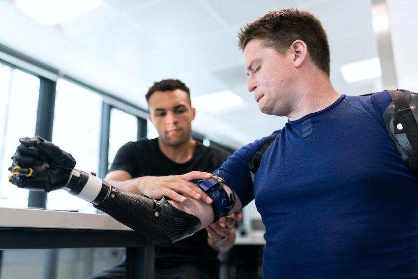 Mechanical engineer fitting a prosthetic limb