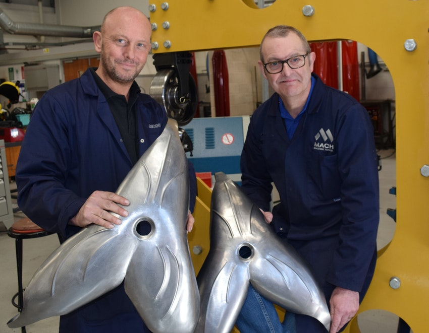 L-R Andy Caie and Steve Pask, Engineering Lecturers, with some of the steel flowers