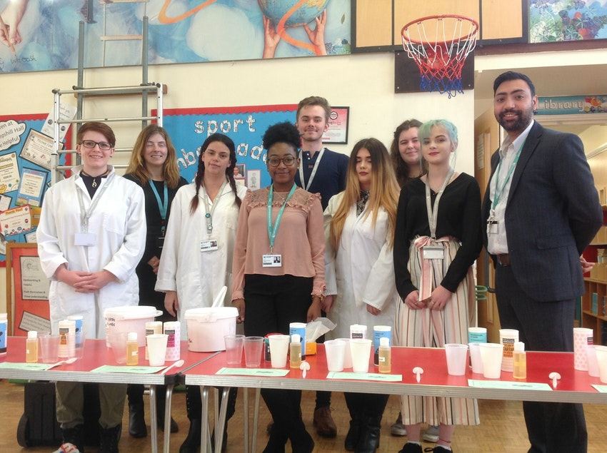 Science Lecturer Jet Tengatenga (front centre, green lanyard), and Work Experience Co-ordinator Dal Singh (far right) with Science students and a representative from Hempshill Hall Primary School (second from left) at the event.