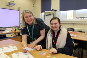 Lecturer Sally Hardwick with Entry 3 Advanced student Beth Dunks-Hopper during a Maths workshop
