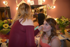 Harriet Hollowell has her hair and make-up done by one of our students