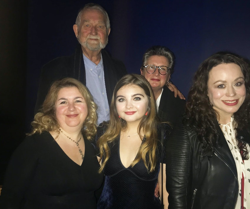 Mia (centre) with Media and Film Lecturer Zoe Cutter (right), plus her friends and family at the screening