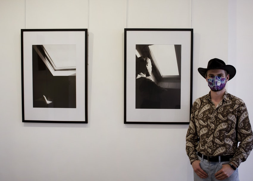 Lewis Andrews with his artwork 'Quarantined Light'