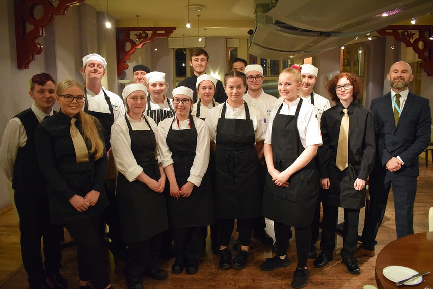 kitchen and front of house students with Louisa Ellis (front, third from right)
