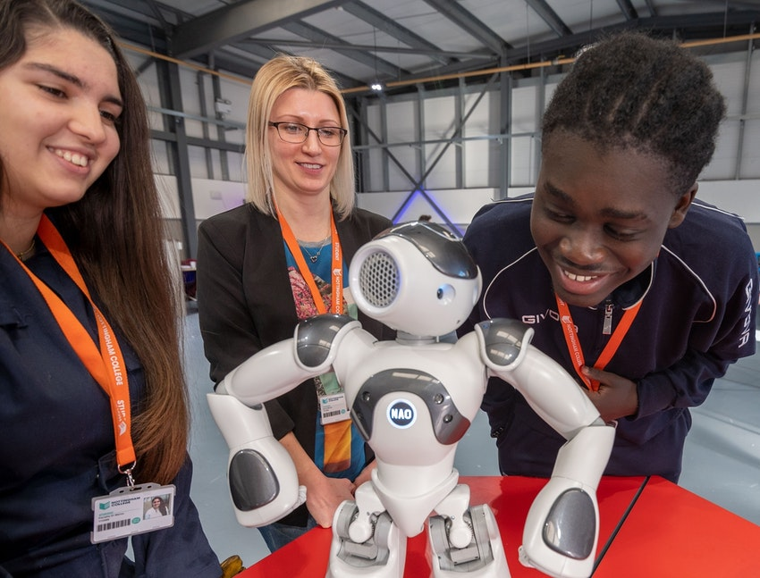 l-r Engineering students Fiorella Di Marco, Anna Maroz and Kojo Amuzu get to know the NAO robot in the STEM Centre