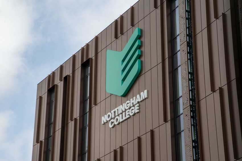 Exterior shot of the side of the Nottingham College City Hub with teal crest logo