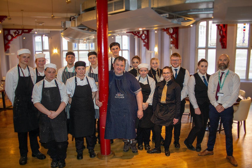 Johnny Pusztai with the students at Adams Restaurant