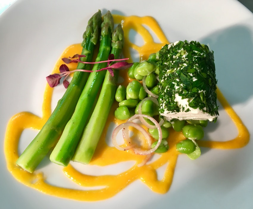 Poached asparagus, herbed goats cheese, broad beans, tomato emulsion