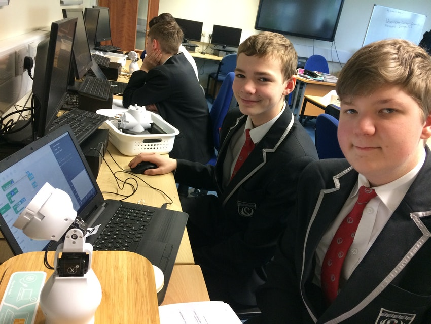 Two pupils from Kirk Hallam Community Academy are pictured programming Fable robots.