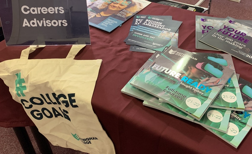 Careers Advisors Sign And College Prospectuses On A Table