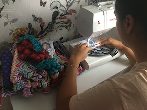 Carmela busy at her sewing machine