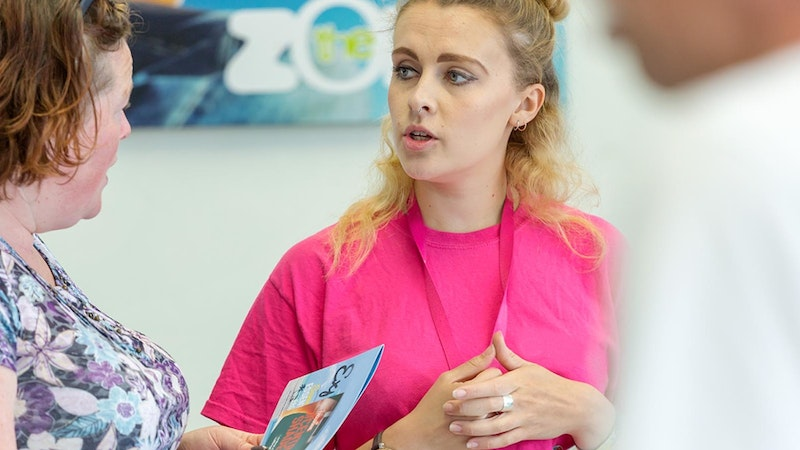 A Nottingham College employee talking to a visitor