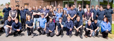 A group shot of public services students at a riot training exercise