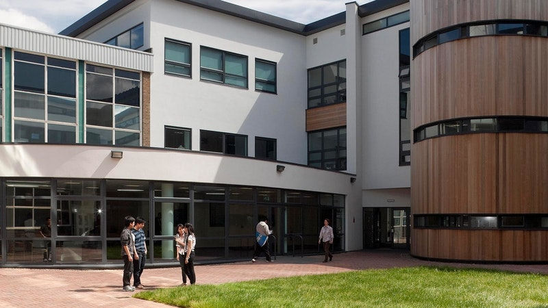 Nottingham College Beeston courtyard during summer with people standing outside on the path