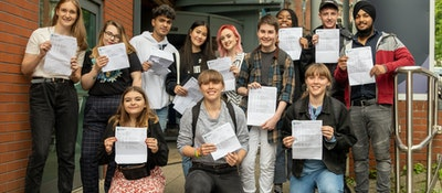 A group shot of A Level students standing outside High Pavement Sixth Form holding their exam results