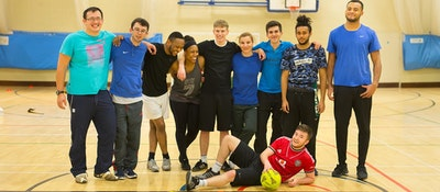 A group of sport students standing in a gymnasium