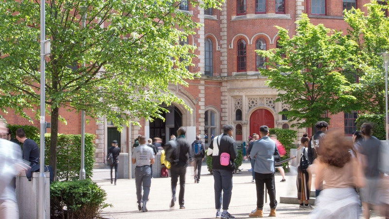 The Lace Market courtyard in summer with students outside the Adams Building front entrance